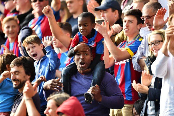 Premier League fans celebrating.