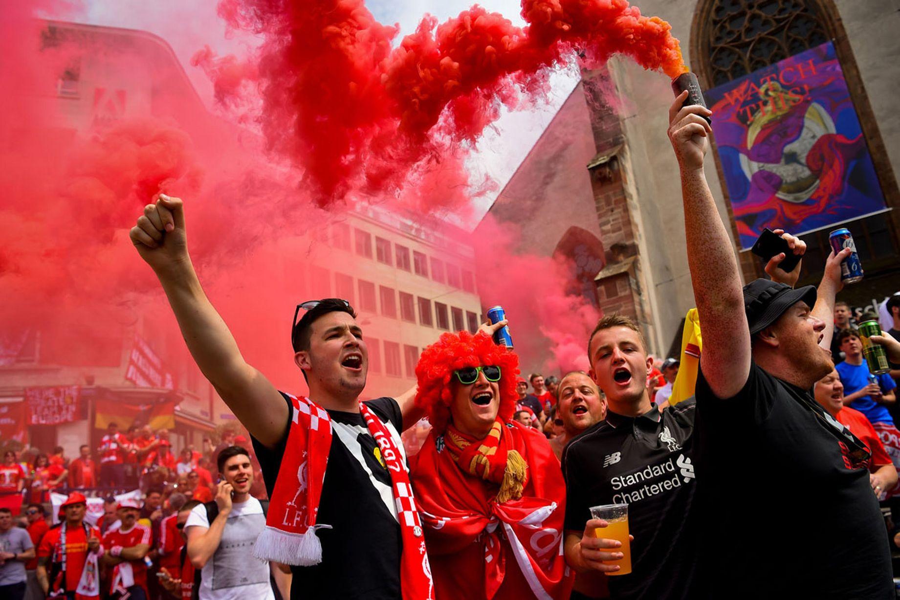 Liverpool fans celebrate/celebrating