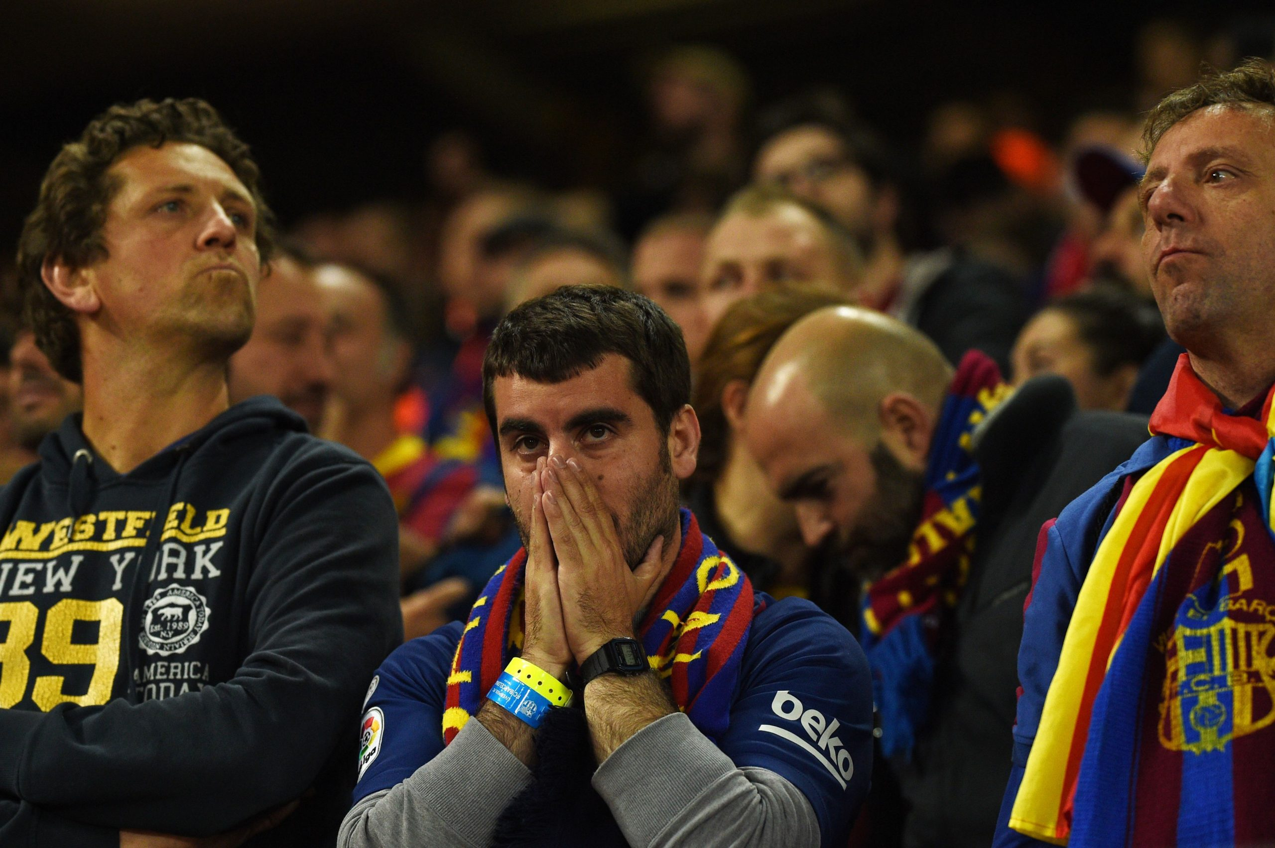 Football fans crying.